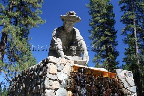 Fountain at Condon Park depicting Miner panning for gold